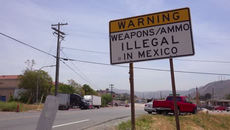 A-sign-announces-that-weapons-and-ammo-are-illegal-in-Mexico-at-the-US-mexico-border