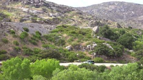 Border-patrol-vehicle-moves-slowly-near-a-railroad-trestle-on-the-US-Mexico-border