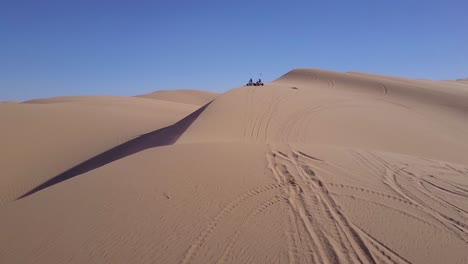 Dune-buggies-and-ATVs-race-across-the-Imperial-Sand-Dunes-in-California