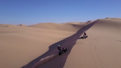 Dune-buggies-and-ATVs-race-across-the-Imperial-Sand-Dunes-in-California-1