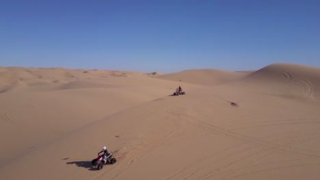 Dune-buggies-and-ATVs-race-across-the-Imperial-Sand-Dunes-in-California-2