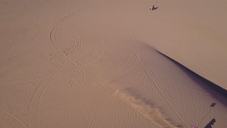 Dune-buggies-and-ATVs-race-across-the-Imperial-Sand-Dunes-in-California-4