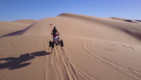 Dune-buggies-and-ATVs-race-across-the-Imperial-Sand-Dunes-in-California-7