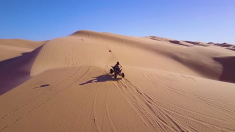 Dune-buggies-and-ATVs-race-across-the-Imperial-Sand-Dunes-in-California-8
