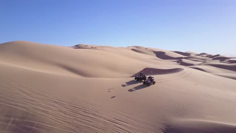 Dune-buggies-and-ATVs-race-across-the-Imperial-Sand-Dunes-in-California-9