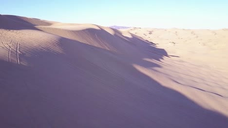 Dune-buggies-and-ATVs-race-across-the-Imperial-Sand-Dunes-in-California-11