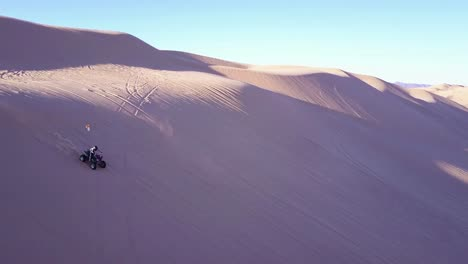Dune-buggies-and-ATVs-race-across-the-Imperial-Sand-Dunes-in-California-12