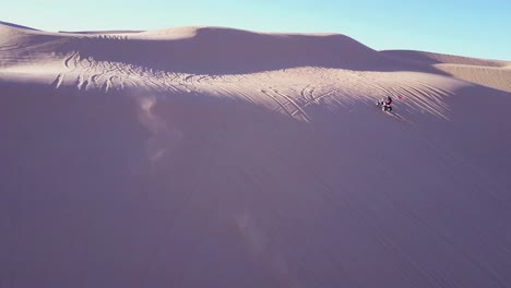 Dune-buggies-and-ATVs-race-across-the-Imperial-Sand-Dunes-in-California-13