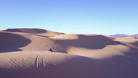 Dune-buggies-and-ATVs-race-across-the-Imperial-Sand-Dunes-in-California-14
