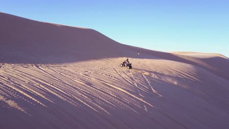Dune-buggies-and-ATVs-race-across-the-Imperial-Sand-Dunes-in-California-17