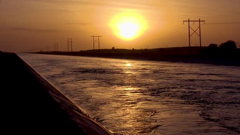 Beautiful-shot-at-sunset-of-the-Imperial-Valley-canal-supplying-water-from-the-Colorado-River-to-San-Diego