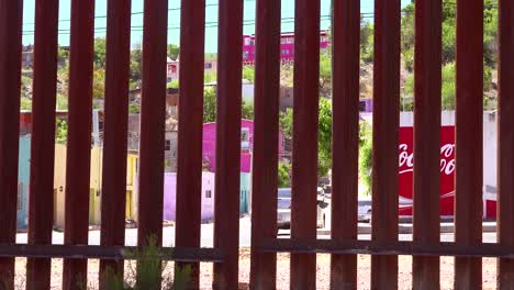 A-view-through-the-US-Mexico-border-wall-towards-the-city-of-Nogales-on-the-other-side