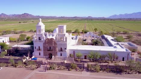 A-beautiful-aerial-establishing-shot-of-Mission-San-Xavier-del-Bac-a-historic-Spanish-Catholic-mission-near-Tucson-Arizona