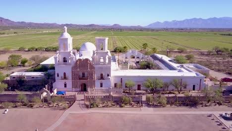 A-beautiful-aerial-establishing-shot-of-Mission-San-Xavier-del-Bac-a-historic-Spanish-Catholic-mission-near-Tucson-Arizona-1