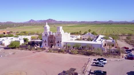 A-beautiful-aerial-establishing-shot-of-Mission-San-Xavier-del-Bac-a-historic-Spanish-Catholic-mission-near-Tucson-Arizona-2