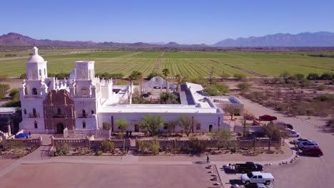A-beautiful-aerial-establishing-shot-of-Mission-San-Xavier-del-Bac-a-historic-Spanish-Catholic-mission-near-Tucson-Arizona-3
