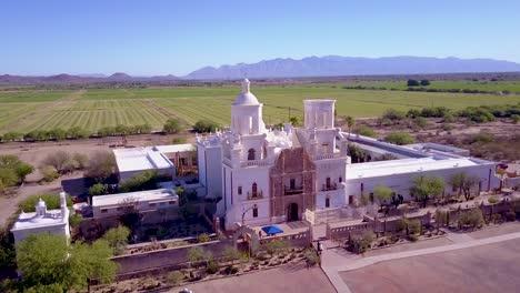 A-beautiful-aerial-establishing-shot-of-Mission-San-Xavier-del-Bac-a-historic-Spanish-Catholic-mission-near-Tucson-Arizona-4