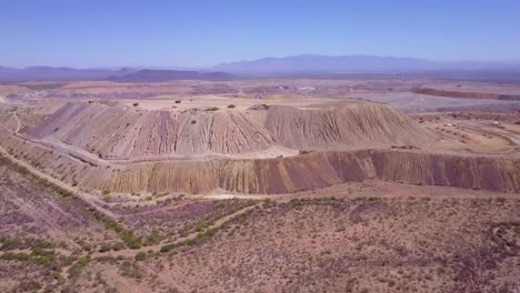 An-aerial-over-a-vast-open-pit-strip-mine-in-the-Arizona-desert