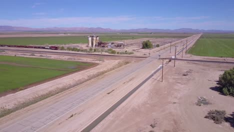 A-high-angle-aerial-over-a-lonely-abandoned-road-through-a-rural-intersection