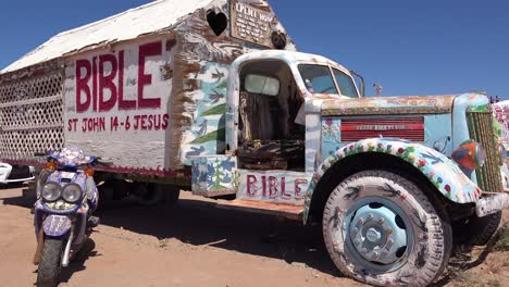 A-truck-painted-with-Bible-verses-and-promoting-Jesus-sits-at-a-Christian-hippy-commune-at-Slab-City-California-1