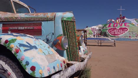 A-truck-painted-with-Bible-verses-and-promoting-Jesus-sits-at-a-Christian-hippy-commune-at-Slab-City-California-2