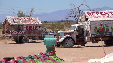 A-trailer-painted-with-Bible-verses-sits-in-the-desert-in-Slab-City-California-1