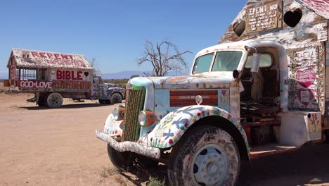 Trucks-painted-with-Bible-verses-and-promoting-Jesus-sit-at-a-Christian-hippy-commune-at-Slab-City-California