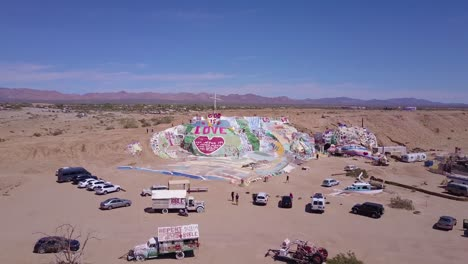 Aerial-over-a-giant-hippy-Christian-art-installation-honors-Jesus-in-the-desert-in-Slab-City-California