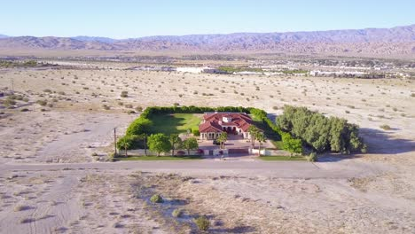 A-dramatic-aerial-reveals-a-large-mansion-in-miles-of-lonely-desert-1