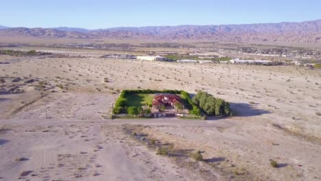 A-dramatic-aerial-reveals-a-large-mansion-in-miles-of-lonely-desert-2