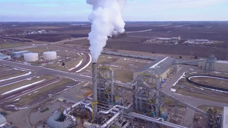 An-aerial-shot-over-an-oil-refinery-spewing-pollution-into-the-air-2