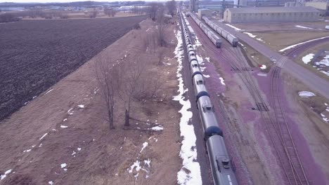 An-aerial-over-an-oil-train-with-tanks-cars-moving-rapidly-down-tracks-1