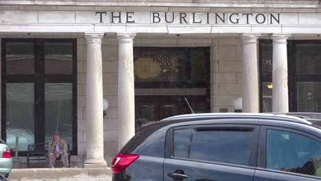 An-old-man-sits-outside-the-Burlington-Hotel-in-small-town-America