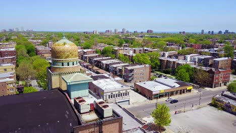 Beautiful-aerial-around-a-Moorish-dome-and-lower-class-neighborhoods-on-the-southside-of-Chicago
