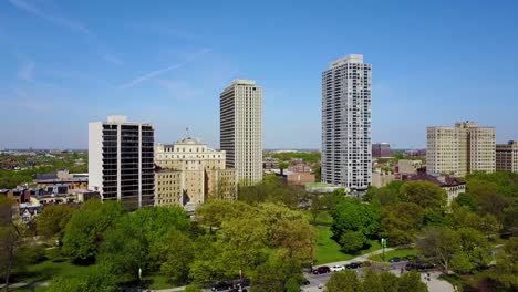 Beautiful-aerial-shot-of-parks-and-high-rise-apartments-along-Lakeshore-Avenue-in-downtown-Chicago