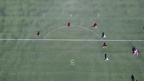 Aerial-shot-over-an-amateur-soccer-match-on-a-soccer-field-1
