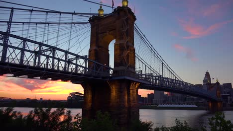 A-beautiful-evening-shot-of-Cincinnati-Ohio-with-bridge-crossing-the-Ohio-River-foreground