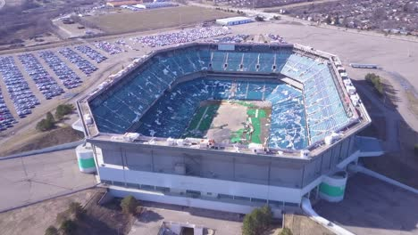 Aerial-over-the-abandoned-and-incredibly-spooky-Pontiac-Silverdome-football-stadium-near-Detroit-Michigan-1