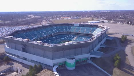 Aerial-over-the-abandoned-and-incredibly-spooky-Pontiac-Silverdome-football-stadium-near-Detroit-Michigan-2