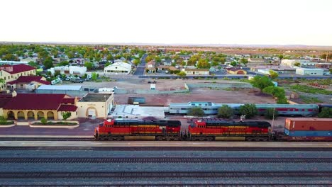 An-aerial-of-a-freight-train-passing-through-Winslow-Arizona