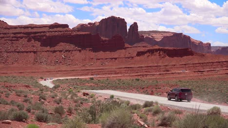 Tourists-drive-through-Monument-Valley-Utah