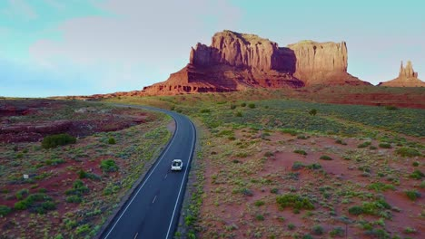 An-aerial-over-a-truck-traveling-on-a-road-through-Navajo-country-in-Arizona