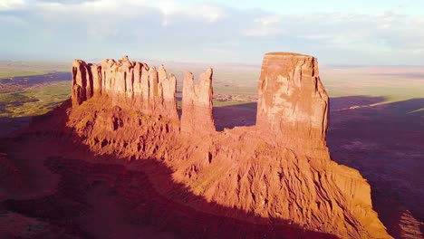 Beautiful-inspiring-aerial-at-sunset-over-rock-formations-in-Monument-Valley-Utah-1