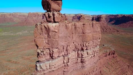 Amazing-rising-aerial-through-the-buttes-and-rock-formations-of-Monument-Valley-Utah