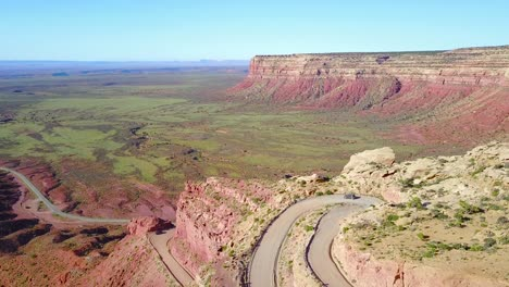 Aerial-as-a-car-travels-on-the-dangerous-mountain-road-of-Moki-Dugway-New-Mexico-desert-Southwest