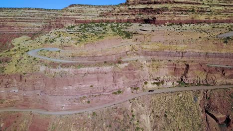 Aerial-as-a-car-travels-on-the-dangerous-mountain-road-of-Moki-Dugway-New-Mexico-desert-Southwest-1