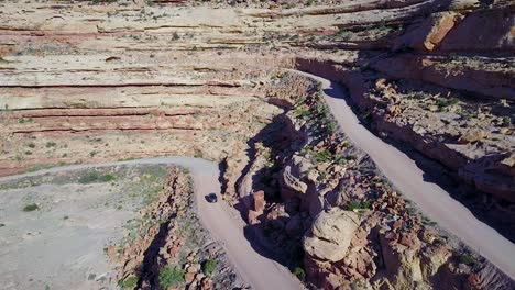 Aerial-as-a-car-travels-on-the-dangerous-mountain-road-of-Moki-Dugway-New-Mexico-desert-Southwest-4