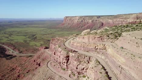 Aerial-as-a-car-travels-on-the-dangerous-mountain-road-of-Moki-Dugway-New-Mexico-desert-Southwest-5