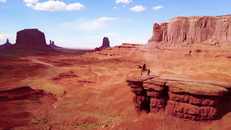 Excellent-aerial-over-a-cowboy-on-horseback-overlooking-Monument-Valley-Utah