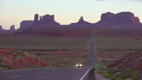 Cars-drive-on-a-highway-near-Monument-Valley-navajo-Tribal-Park-Utah